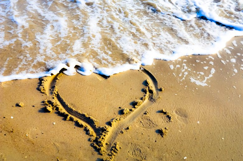 a symbol of love painted in sand